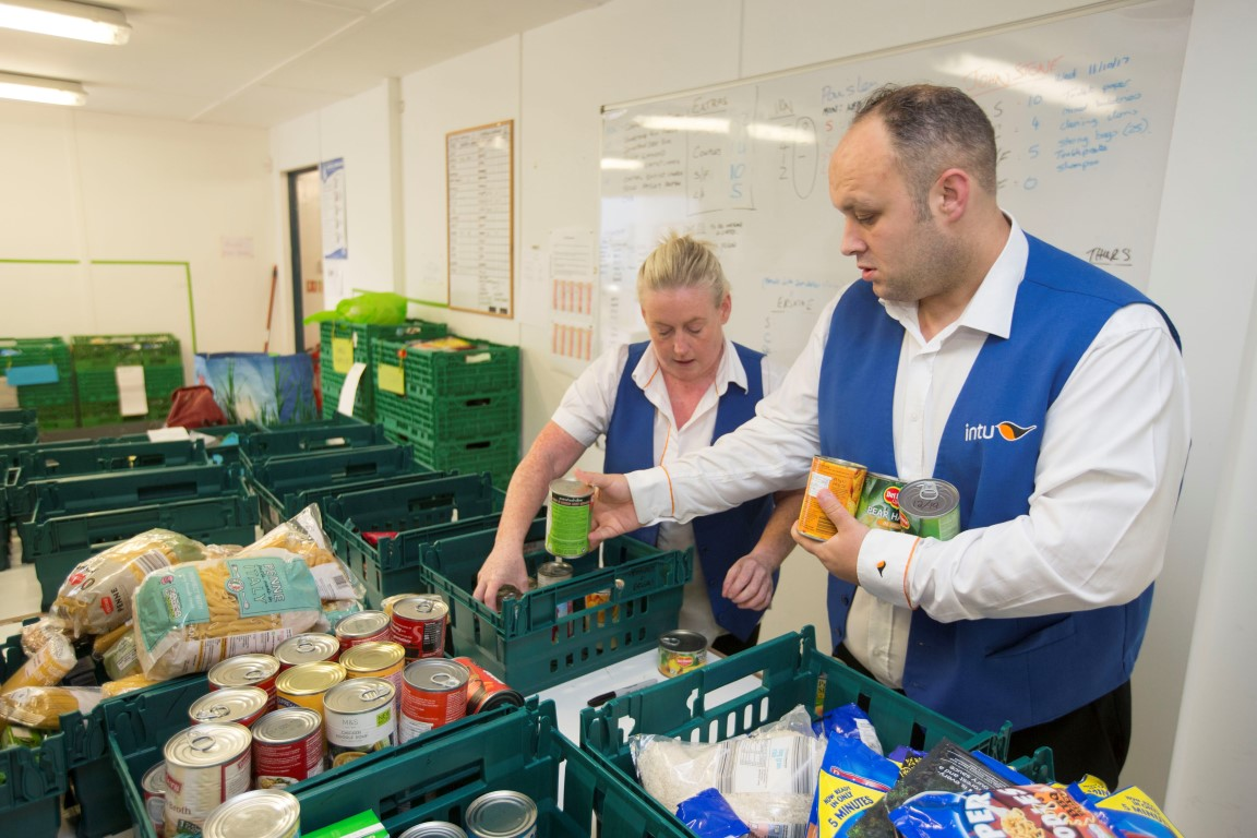Mall staff volunteer to help at foodbank warehouse in Renfrew