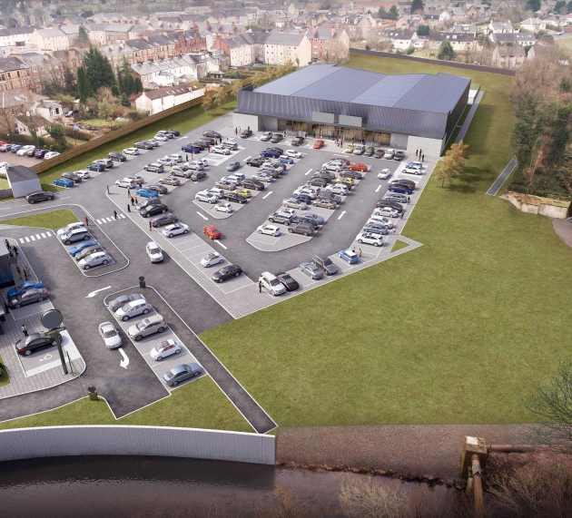 What shops are going into the new retail buildings at Paton's Mill, Johnstone