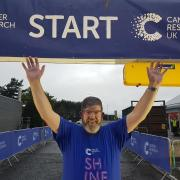 Cancer survivor Ian lights up the night at Shine Glasgow for Cancer Research UK