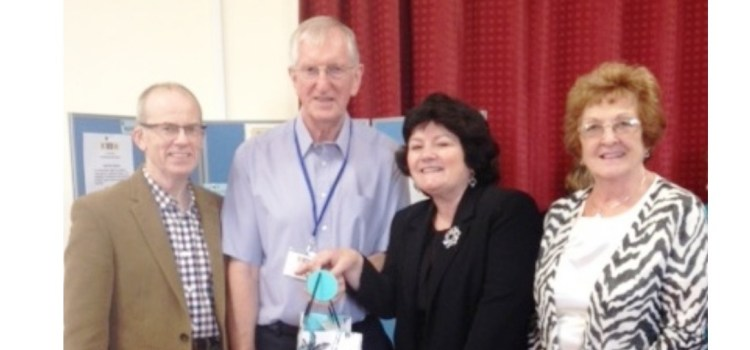 Paisley & District U3A committee members present Dumfries U3A with silver anniversary gift