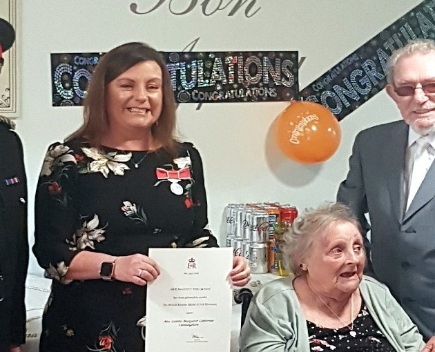 Daughter holds medal ceremony at Johnstone Care Home so mother Cathy Cusack could be part of her special day