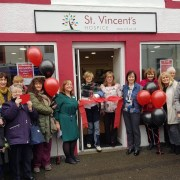 Cor Hutton celebrates the opening of St. Vincent's Charity Shop