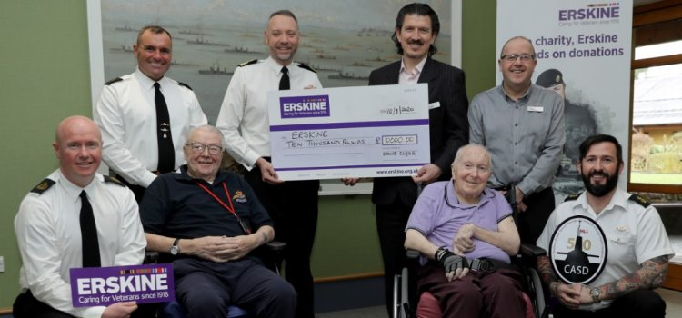 HM Naval Base Clyde staff present cheque to Erskine veterans