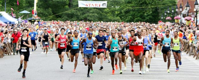 Runners take off at the start of the Litchfield Hills Road Race in Litchfield Sunday. Steven Valenti Republican-American