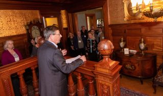 Mark McEachern, Executive Director at the Torrington Historical Society, welcomes gueste and dignitaries during a reception and tour to celebrate the completion of the restoration of the Hotchkiss Bedroom inside the Hotchkiss-Fyler House Museum at the Torrington Historical Society on Thursday. Jim Shannon Republican-American