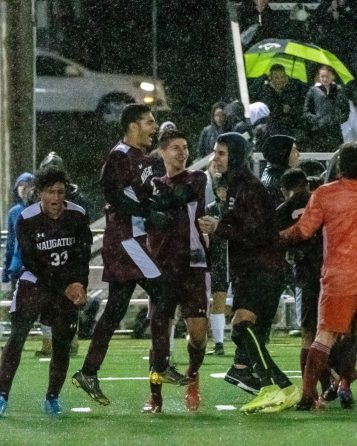 WATERBURY, CT. 07 November 2019-110719BS576 - The Naugatuck boys soccer team celebrates on the field after beating Woodland 2-1, during the NVL Boys Soccer final between Naugatuck and Woodland at Municipal Stadium on Thursday. Bill Shettle Republican-American