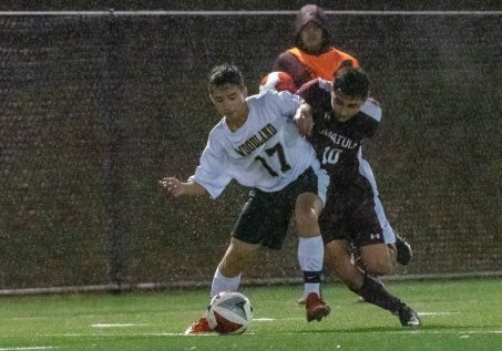WATERBURY, CT. 07 November 2019-110719BS576 - Woodland's And Krivca (17) and Naugatuck's Ahmed Aljamal (10) battle for the ball in the pouring rain, during the NVL Boys Soccer final between Naugatuck and Woodland at Municipal Stadium in Waterbury on Thursday.The Naugatuck boys soccer team are the 2019 NVL Champions after beating Woodland 2-1. Bill Shettle Republican-American