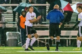 WATERBURY, CT. 07 November 2019-110719BS576 - Woodland's Dante Polletta (25) pleads with the referee before being given a yellow card for rough play, during the NVL Boys Soccer final between Naugatuck and Woodland at Municipal Stadium in Waterbury on Thursday. The Naugatuck boys soccer team are the 2019 NVL Champions after beating Woodland 2-1. Bill Shettle Republican-American