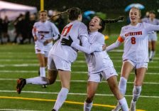 WATERBURY, CT. 07 November 2019-110719BS02 - Watertown teammates Morgan Dodge (11), left, and Maddie Daigneault (8), right, rush in to celebrate with Torri DiStefano (1), center, scoring of a goal, during the NVL Girls Soccer final between Holy Cross and Watertown at Municipal Stadium on Thursday. Holy Cross came back from being two goals down to beat Watertown 3-2 and being crowned the 2019 NVL Champions. Bill Shettle Republican-American