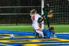 WATERBURY, CT. 07 November 2019-110719BS02 - Watertown goalkeeper Makayla Beauty, right, falls to the ground trying make a save on the ball on Holy Cross' Juliana Dane (19), center, with Watertown's Malina LaCapra (6), defending, during the NVL Girls Soccer final between Holy Cross and Watertown at Municipal Stadium on Thursday. Holy Cross came from two goals down to beat Watertown 3-2. Bill Shettle Republican-American