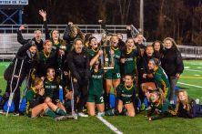 Holy Cross' girls soccer team players erupt in celebration on the field after taking a photo raising the trophy and being crowned the 2019 NVL Champions at Municipal Stadium on Thursday. Holy Cross came back from being two goals down to beat Watertown 3-2 . Bill Shettle Republican-American