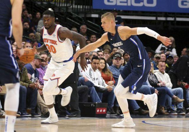 New York Knicks forward Julius Randle (30) is pursued by Dallas Mavericks forward Kristaps Porzingis (6) in the first half in an NBA basketball game Friday, Nov. 8, 2019, in Dallas. (AP Photo/Richard W. Rodriguez)