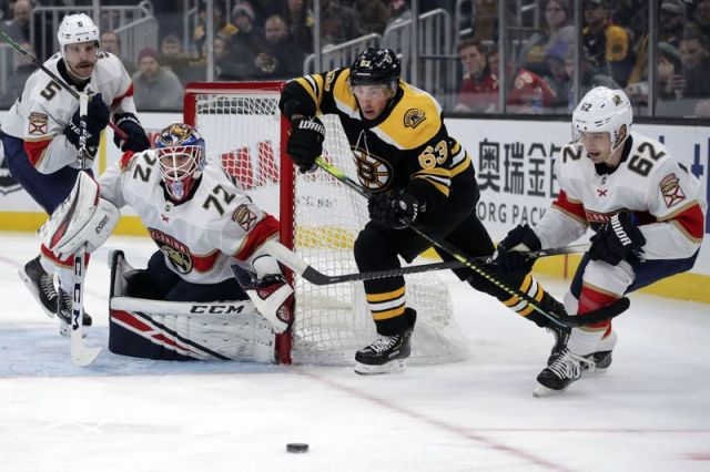 Boston Bruins center Brad Marchand (63) tries to break free against the Florida Panthers during the second period of an NHL hockey game in Boston, Tuesday, Nov. 12, 2019. (AP Photo/Charles Krupa)