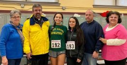 The Rev. Anthony Smith, pastor, and Carmelina Calabrese, director of religious education, far right, were leading the team from John the Evangelist Church, Watertown, which won the Top Team prize