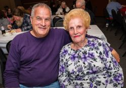 Mark Polzella and his mother Mary Polzella both of Waterbury enjoy themselves at the Hopeville Church's annual fundraiser dinner and silent auction at the Hopeville Church in Waterbury on Wednesday. Bill Shettle Republican-American