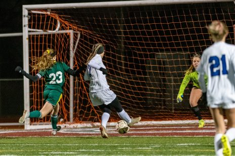 NAUGATUCK, CT. 20 November 2019-112019BS870 - Litchfield's Christina Orsini (7) shoots and scores a goal against Holy Cross' Alyssa Milburn (23) and past Holy Cross goalkeeper Tori Schaffner (24), during the Girls Soccer Class S semifinal match between Litchfield and Holy Cross at Naugatuck High School on Wednesday. Holy Cross beat Litchfield 3-1 and advance to the Class S final this Saturday. Bill Shettle Republican-American