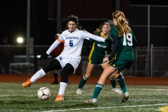 NAUGATUCK, CT. 20 November 2019-112019BS874 - Litchfield's Lucy Kraut (6), left, puts a move on Holy Cross' Juliana Dane (19), during the Girls Soccer Class S semifinal match between Litchfield and Holy Cross at Naugatuck High School on Wednesday. Holy Cross beat Litchfield 3-1 and advances to the Class S final this Saturday. Bill Shettle Republican-American