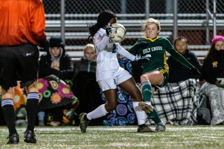 NAUGATUCK, CT. 20 November 2019-112019BS875 - Holy Cross' Alexa Diorio (3), right, clears the ball off the hand of Litchfield's Jeremina Prenoveau (22), during the Girls Soccer Class S semifinal match between Litchfield and Holy Cross at Naugatuck High School on Wednesday. Holy Cross beat Litchfield 3-1 and advances to the Class S final this Saturday. Bill Shettle Republican-American