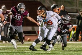 NAUGATUCK, CT. 21 November 2019-112119BS418 - Watertown's Owen Munson (85), center, runs with the ball after catching a pass slipping the tackle by Naugatuck's Amarion Akinsanya (22) as Naugatuck's Aaron Smith (48) races down behind, during a NVL Football game between Watertown and Naugatuck at Naugatuck High School on Thursday. Bill Shettle Republican-American