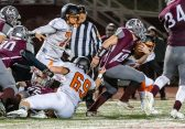 NAUGATUCK, CT. 21 November 2019-112119BS419 - Naugatuck's Aaron Smith (48), right, runs with the ball dragging Watertown's Matthew Hardisty (69), during a NVL Football game between Watertown and Naugatuck at Naugatuck High School on Thursday. Bill Shettle Republican-American