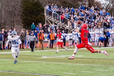 CHESHIRE, CT. 28 November 2019-112819BS1265 - Cheshire's Nicholas DiDomizio (12), right, catches the ball in front of Southington's John Carreiro (25) for a touchdown in the second overtime, during a SCC game and the annual Cheshire vs Southington Thanksgiving game called the Apple Valley Classic at Cheshire High School on Thursday. Southington won 21-20 in double overtime. Bill Shettle Republican-American
