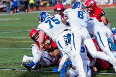 CHESHIRE, CT. 28 November 2019-112819BS1267 - Cheshire quarterback Jason Shumilla (14), left, is stopped by the Southington defense going for a two point conversion and the win just inches from the goal line, during a SCC game and the annual Cheshire vs Southington Thanksgiving game called the Apple Valley Classic at Cheshire High School on Thursday. Southington won 21-20 in double overtime. Bill Shettle Republican-American