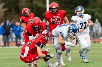 CHESHIRE, CT. 28 November 2019-112819BS1252 - Southington's Dillon Kohl (42), left, runs through the defense of Cheshire's Ryan Mancl (23), on his way to a 24 yard touchdown, during a SCC game and the annual Cheshire vs Southington Thanksgiving game called the Apple Valley Classic at Cheshire High School on Thursday. Southington won 21-20 in double overtime. Bill Shettle Republican-American