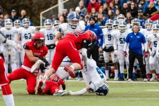CHESHIRE, CT. 28 November 2019-112819BS1252 - Southington's Jack McManus (6), lands on his head after being upended by Cheshire's Benjamin Wable (10) and tackled by Cheshire's Jacob Dubois (42), during a SCC game and the annual Cheshire vs Southington Thanksgiving game called the Apple Valley Classic at Cheshire High School on Thursday. Southington won 21-20 in double overtime. Bill Shettle Republican-American