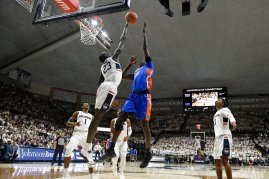 Connecticut's Akok Akok (23) blocks a shot by Florida's Gorjok Gak during the first half of an NCAA college basketball game, Sunday, Nov. 17, 2019, in Storrs, Conn. (AP Photo/Jessica Hill)