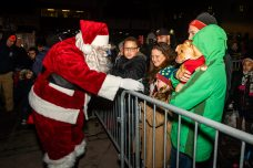 WATERBURY, CT. 08 December 2019-120819BS16 - Santa arrives greeting kids with gifts and treats, during the annual lighting of the Christmas Tree and the surrounding lights on the City Green to help launch the Holiday Season in downtown Waterbury on Sunday. The lighting ceremony was pushed backed on week due to the snowstorm last weekend. Bill Shettle Republican-American