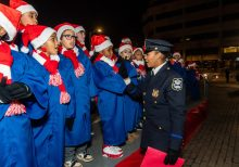 WATERBURY, CT. 08 December 2019-120819BS15 - Detective Andrea Saunders, right, talks to the PAL Children's Chorus before they sing Christmas carols, during the the annual lighting of the Christmas Tree and surrounding lights on the City Green to launch the Holiday Season in downtown Waterbury on Sunday. The lighting ceremony was pushed backed on week due to the snowstorm last weekend. Bill Shettle Republican-American
