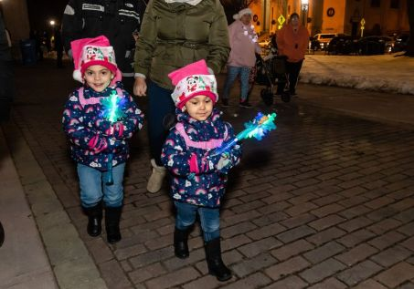 WATERBURY-- Kailiany Vasquez, 4, and her sister Kayroma, 2, both of Waterbury walk around with their brightly lit snowflakes, during the annual lighting of the Christmas Tree and surrounding lights on the City Green to help launch the Holiday Season in downtown Waterbury on Sunday. The lighting ceremony was pushed backed on week due to the snowstorm last weekend. Bill Shettle Republican-American