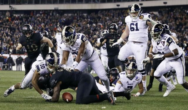 FILE - In this Dec. 8, 2018, file photo, Army's James Gibson (2) recovers a fumble against Navy's Malcolm Perry (10) and OJ Davis (86) during the second half of an NCAA college football game in Philadelphia. The 120th Army-Navy game is set for Saturday in Philadelphia. Army is trying to win its fourth straight game in the series. (AP Photo/Matt Slocum, File)