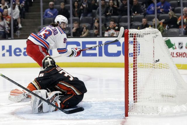 New York Rangers' Mika Zibanejad, top left, scores past Anaheim Ducks goaltender John Gibson during the first period of an NHL hockey game Saturday, Dec. 14, 2019, in Anaheim, Calif. (AP Photo/Marcio Jose Sanchez)
