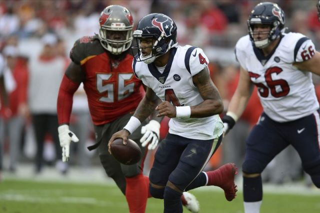 Houston Texans quarterback Deshaun Watson (4) outruns Tampa Bay Buccaneers defensive tackle Rakeem Nunez-Roches (56) during the second half of an NFL football game Saturday, Dec. 21, 2019, in Tampa, Fla. (AP Photo/Jason Behnken)