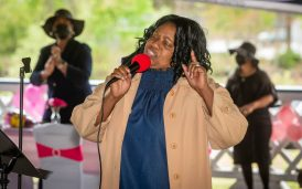 Vickie Howard-Steward sings a song during a Mother's Day celebration held Saturday at Lakewood Park in Waterbury. The event was hosted by the Black Women United Committee. Jim Shannon Republican American