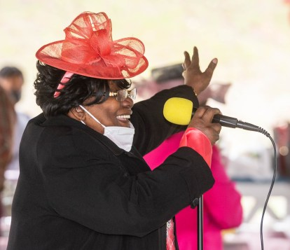 Honoree Patricia Morrison , Spiritual Mother, shows her excitement to be honored along with three others, during a Mother's Day celebration held Saturday at Lakewood Park in Waterbury. The event was hosted by the Black Women United Committee. Jim Shannon Republican American