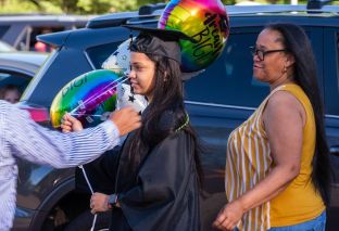 Cristina Peguero of Torrington, who earned her degree as a medical assistant, is seen with her mother, Cristina Barrera, before Northwestern Connecticut Community College's graduation ceremonies Thursday at Five Points Center for the Visual Arts in Torrington. Jim Shannon Republican-American