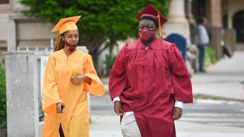 Sacred Heart graduates Monica Reisman and Gavyn Samedi walk around prior to the 99th annual commencement exercises for Sacred Heart High School Friday at The Basilica of the Immaculate Conception in Waterbury. Jim Shannon Republican American