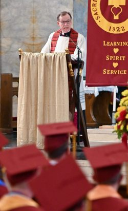 The Reverend Monsignor Joseph T. Donnelly, Sacred Heart Class of 1967, gives the graduation address to the Class of 2021 during the 99th annual commencement exercises for Sacred Heart High School Friday at The Basilica of the Immaculate Conception in Waterbury. Jim Shannon Republican American