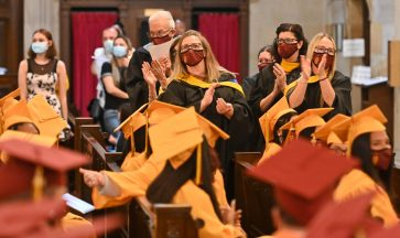 Sacred Heart faculty members stand and applaud the Class of 2021 during the 99th annual commencement exercises for Sacred Heart High School Friday at The Basilica of the Immaculate Conception in Waterbury. Jim Shannon Republican American