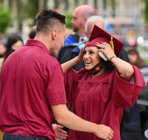 Sacred Heart Class of 2020 graduateNicole DaSliva gets a congratulatory hug from track coach John Ducham following the 99th annual commencement exercises for Sacred Heart High School Friday at The Basilica of the Immaculate Conception in Waterbury. Some members of the Class of 2020 were allowed to participate since they did not have a ceremony last year. Jim Shannon Republican American