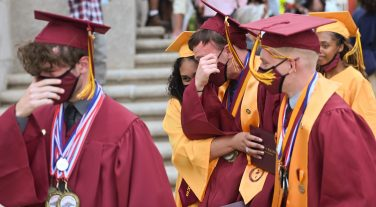 A group of student get emotional as they gather following the 99th annual commencement exercises for Sacred Heart High School Friday at The Basilica of the Immaculate Conception in Waterbury. The Class of 2021 is the final class to graduate from Sacred Heart which is closing at the end of the school year. Jim Shannon Republican American