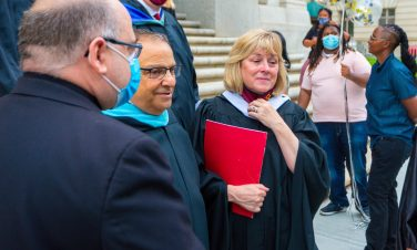 Fighting back emotions Sacred Heart principal Anthony Azzara and President Eileen M. Regan, make their way out following the 99th, and final, commencement exercises for Sacred Heart High School Friday at The Basilica of the Immaculate Conception in Waterbury. Jim Shannon Republican American