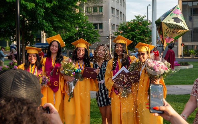 Sacred Heart graduates post for photos for friends and family on the Waterbury Green following the 99th annual commencement exercises for Sacred Heart High School Friday at The Basilica of the Immaculate Conception in Waterbury. Jim Shannon Republican American