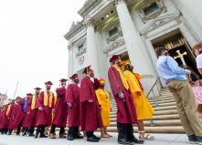 Sacred Heart graduates make way into The Basilica of the Immaculate Conception in Waterbury on Friday for during the 99th annual commencement exercises. Jim Shannon Republican American