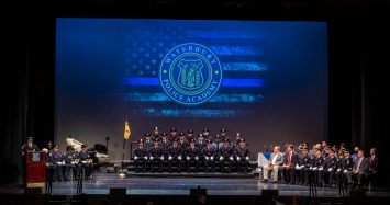 Recruits from the Waterbury Police Academy Class 2020-01 during basic training graduation ceremonies Tuesday at the Palace Theater in Waterbury. The academy graduated 18 officers. Jim Shannon Republican American