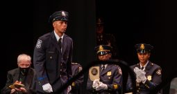 Waterbury Police Academy recruit Aaron Alibocas makes his way to receive the Mendelssohn Award received during basic training graduation ceremonies for the Waterbury Police Academy Class 2021-01 Tuesday at the Palace Theater in Waterbury. Jim Shannon Republican American