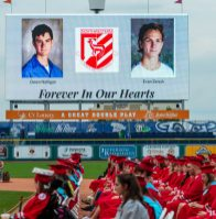 Two Northwestern Regional High School students, Owen Nelligan and Evan Zenuh, were remembered with a moment of silence during graduation ceremonies Wednesday at Dunkin' Donuts Park in Hartford. Jim Shannon Republican American