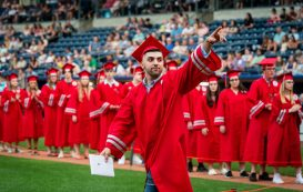 Northwestern Regional High School graduate Sedin Gutic acknowledges his family after receiving his diploma during graduation ceremonies Wednesday at Dunkin' Donuts Park in Hartford. Jim Shannon Republican American